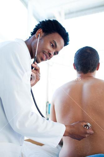 Attractive doctor attending a patient