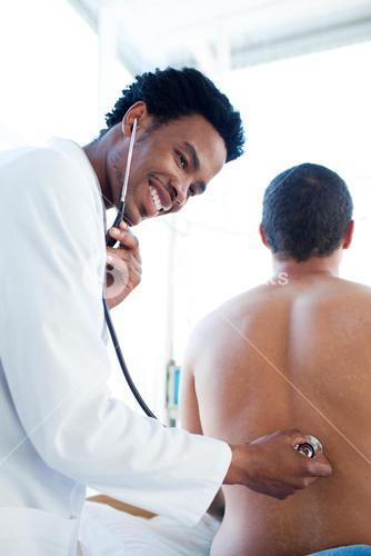 Doctor attending a male patient