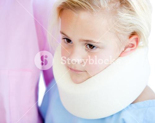 Close up of a little girl with a neck brace