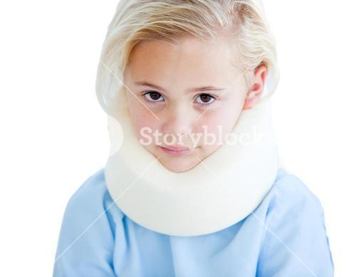 Portrait of a little girl with a neck brace against a white background