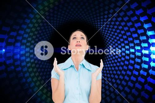 Composite image of concerned young businesswoman praying