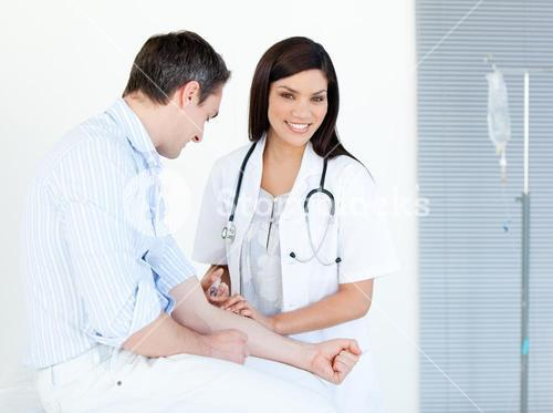 Smiling female doctor making injection to her patient