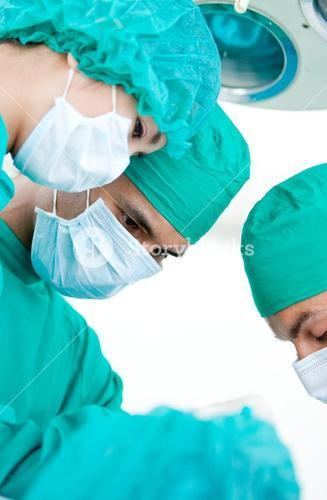 Medical partners looking at the patient