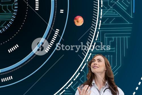 Composite image of happy doctor throwing apple