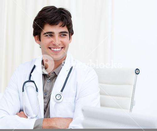 Selfassured male doctor smiling in his office