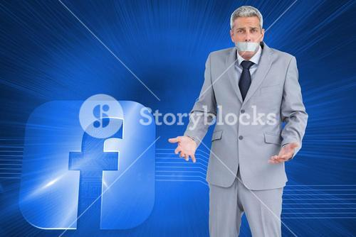 Composite image of businessman gagged with adhesive tape on mouth
