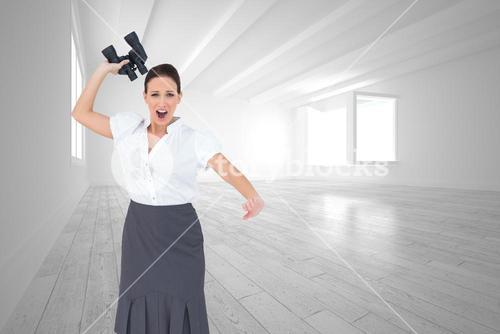 Composite image of angry businesswoman throwing binoculars away