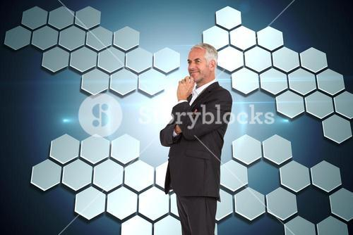 Composite image of happy businessman looking away