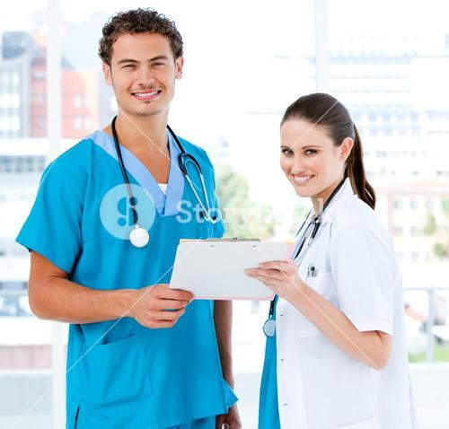 Smiling partners holding a patient diagnosis