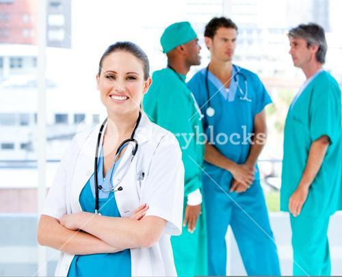 Radiant female doctor looking at the camera while her medical partners talking together