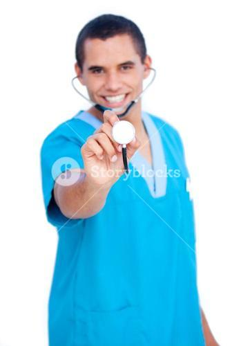 Selfassured male doctor wearing blue uniform holding a stethoscope against white background