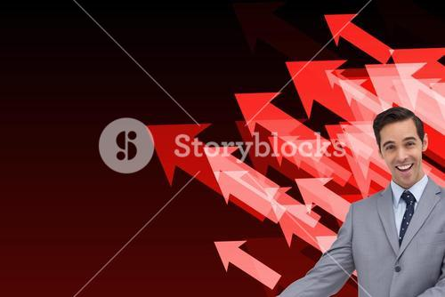 Composite image of happy businessman giving a presentation with his hands