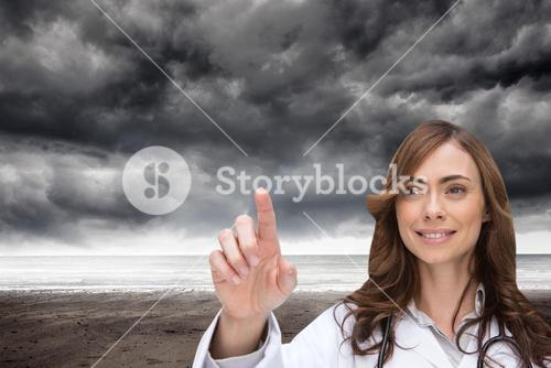 Composite image of smiling doctor pointing