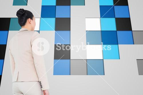 Composite image of asian businesswoman walking