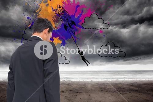 Composite image of rocket on splashes over stormy background