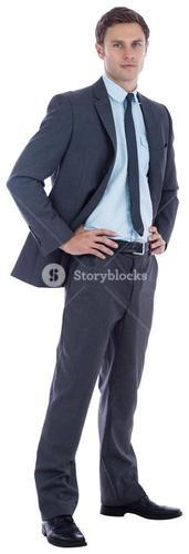 Serious businessman with hands on hips