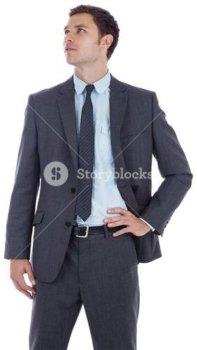 Serious businessman with hand on hip