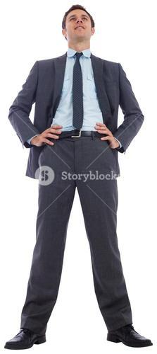Happy businessman with hands on hips