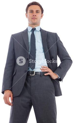 Stern businessman with hand on hip