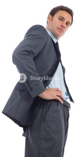 Stern businessman standing with hands on hips