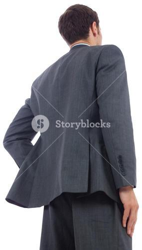 Businessman standing with hand on hip