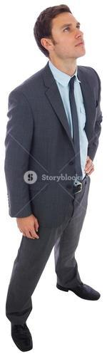 Stern businessman standing with hand on hip