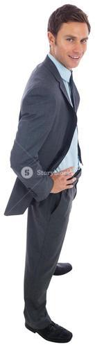Cheerful businessman standing with hands on hips