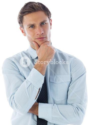Thinking businessman with hand on chin
