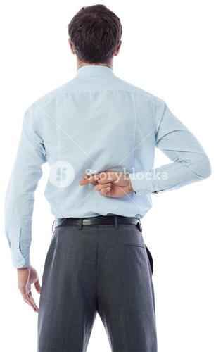 Businessman crossing fingers behind his back