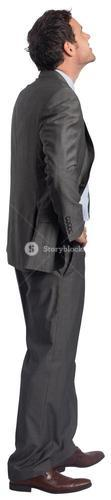 Smiling businessman with hand on hip