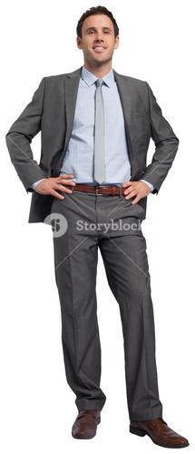 Smiling businessman with hands on hips