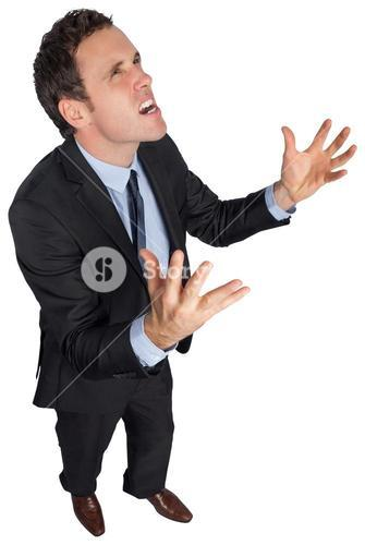 Stressed businessman gesturing