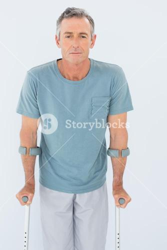 Portrait of a mature man with crutches