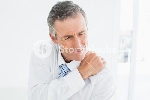 Closeup of a mature man suffering from shoulder pain