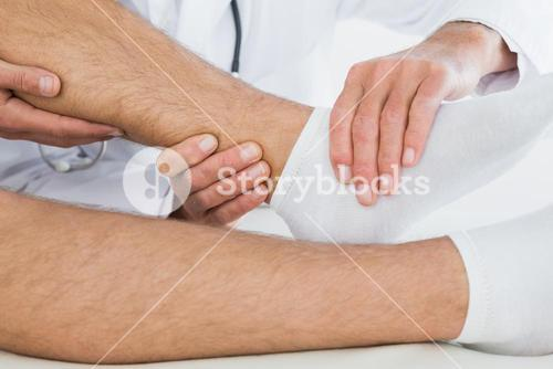Extreme closeup of a man getting his ankle examined