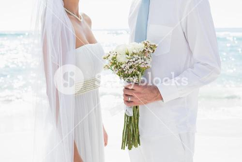 Bride and groom facing each other