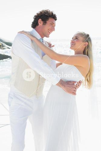 Groom dipping his pretty new wife while dancing