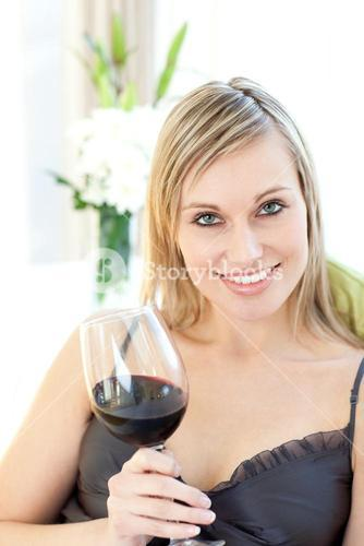 Jolly woman drinking red wine