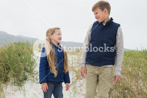 Happy brother and sister at beach