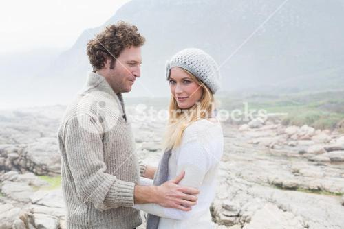 Couple standing together on a rocky landscape
