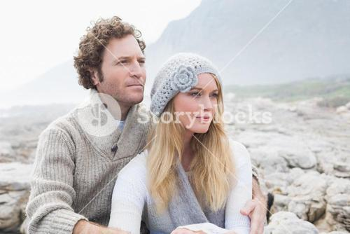 Couple sitting together on a rocky landscape