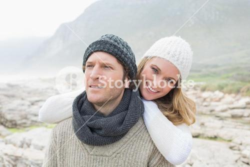 Romantic couple together on a rocky landscape