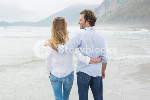 Rear view of a romantic couple at beach