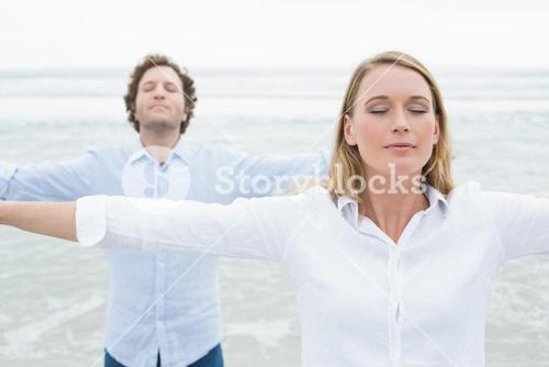 Peaceful couple with eyes closed at beach