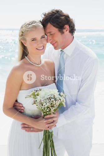 Content couple on their wedding day bride smiling at camera