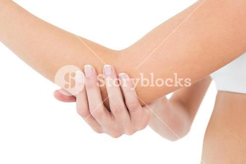 Closeup mid section of a woman with elbow pain