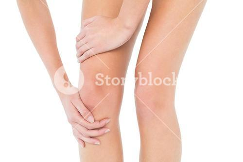 Closeup mid section of a woman with knee pain