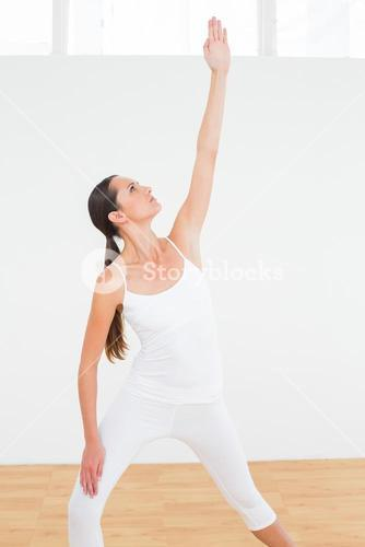 Fit woman doing pilate exercises in fitness studio