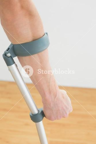 Closeup of a mans hand with crutch