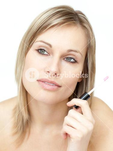 Portrait of a beautiful woman holding a gloss